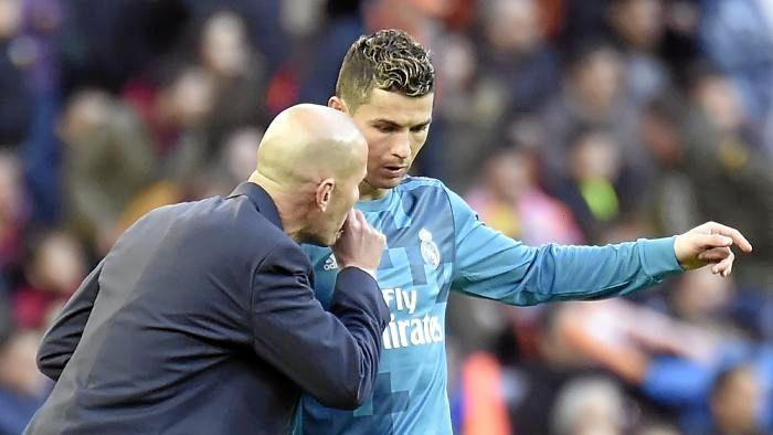Cristiano Ronaldo with Real Madrid coach Zinedine Zidane.