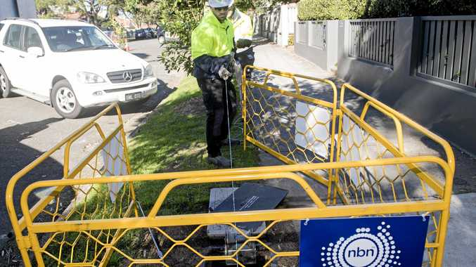 Contractors working with the rollout of the NBN network. (AAP Image/Brendan Esposito)