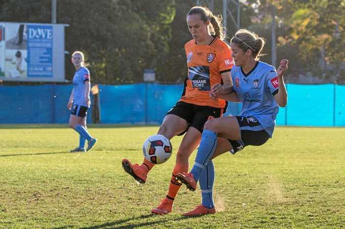 WINNER: Toowoomba's Abbey Lloyd (left) scored twice in the Brisbane Roar's 4-1 win over Canberra United. The win secured the W-League minor premiership for the Roar.