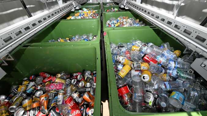 Deposited bottles are stacked into bins at the rear of the 'Return and Earn' recycling station at the BP service station, Chinderah Bay Drive, Chinderah.