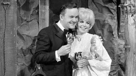 Crane poses with fellow cast member Sigrid Valdis after they were married on the studio set in Hollywood, Oct. 16, 1970.