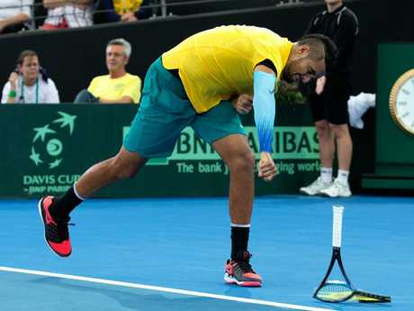 Kyrgios gives his racquet a beating. Picture: Getty Images