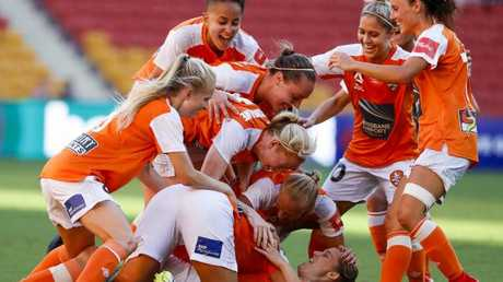 Abbey Lloyd celebrates with teammates after scoring a goal in the Roar's 4-1 home win over Canberra United. Picture: AAP