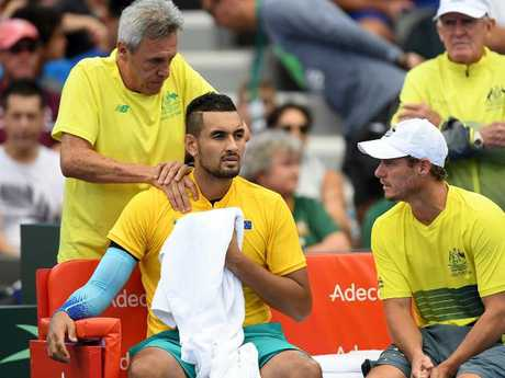 Kyrgios receives medical treatment.