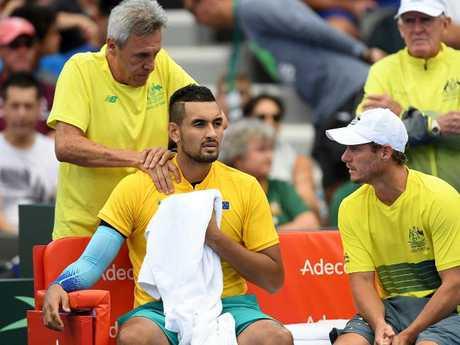 Kyrgios receives medical treatment.