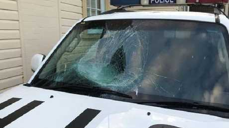 A naked man smashed his head through front window of the police car at Byron Bay.
