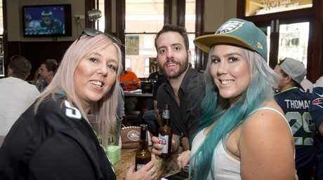 ( From left ) Toni Whiteley, Josh Lynch and Lisa Whiteley. Patrons at the Spotted Cow watch the Patriots vs the Eagles in the Super Bowl. Monday, 4th Feb, 2018.