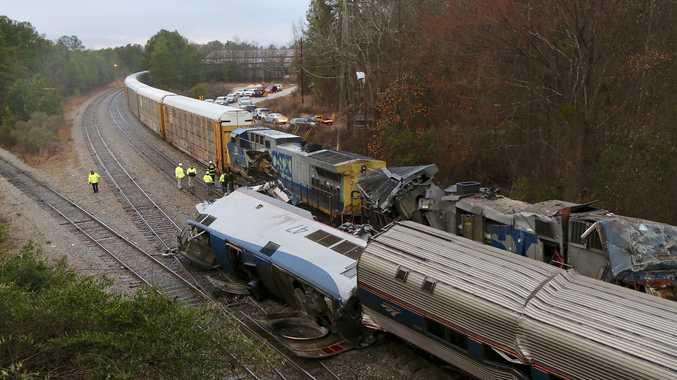 Authorities investigate the scene of a fatal Amtrak train crash in Cayce, South Carolina, Sunday, Feb. 4, 2018. At least two were killed and dozens injured. (Tim Dominick/The State)