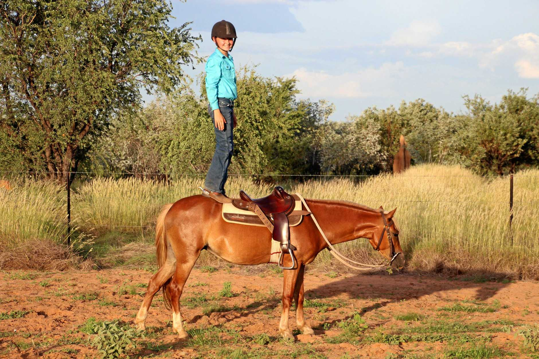 Annabelle Towne, from Gogo Station, standing on Pumpkin. The Welsh mountain pony will be auctioned off to raise money for Dolly's Dream Foundation.