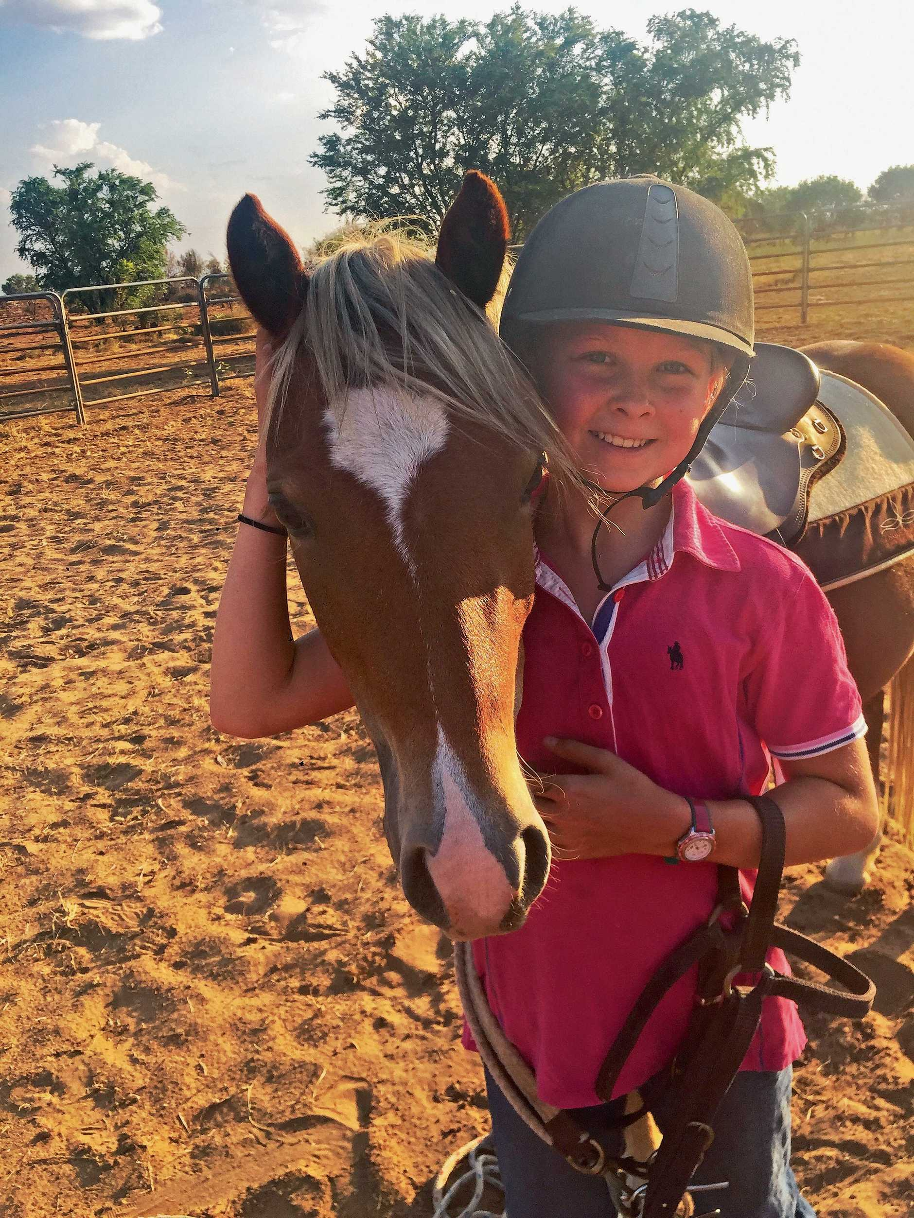 Annabelle Towne with Pumpkin, a three-year-old welsh mountain pony that will be auctioned off to raise money for Dolly's Dream Foundation.