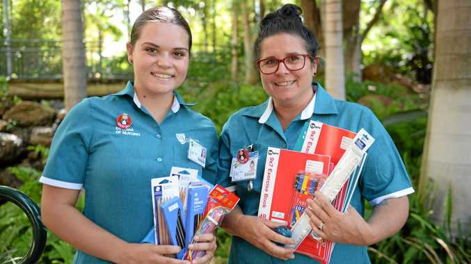 Georgie Smith and Charmaine Cooke with supplies for their trip to India.