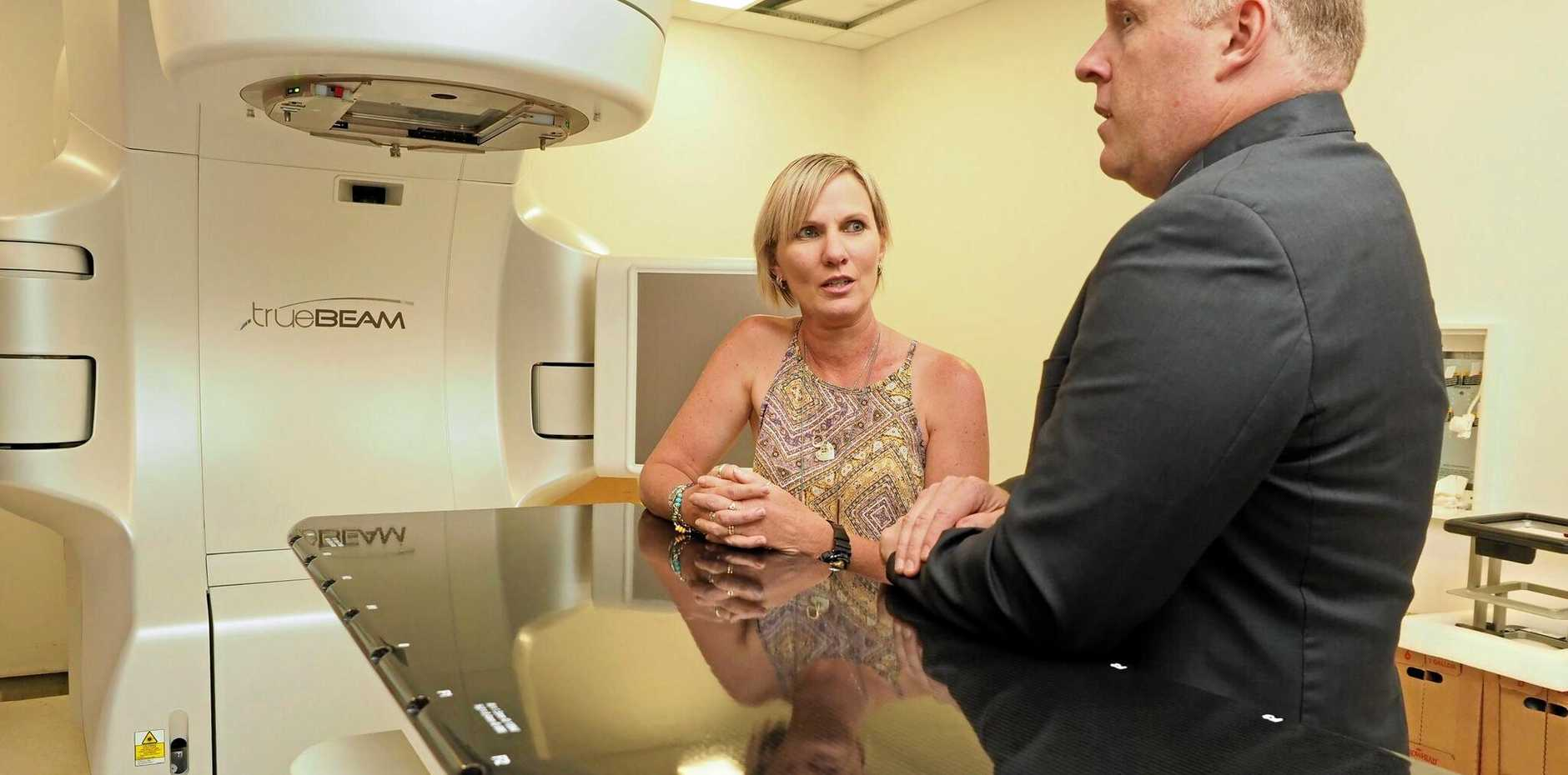 Mackay cancer survivor Raelene Refalo and Icon Group CEO Mark Middleton with the new linear accelerator at the Mackay cancer centre.