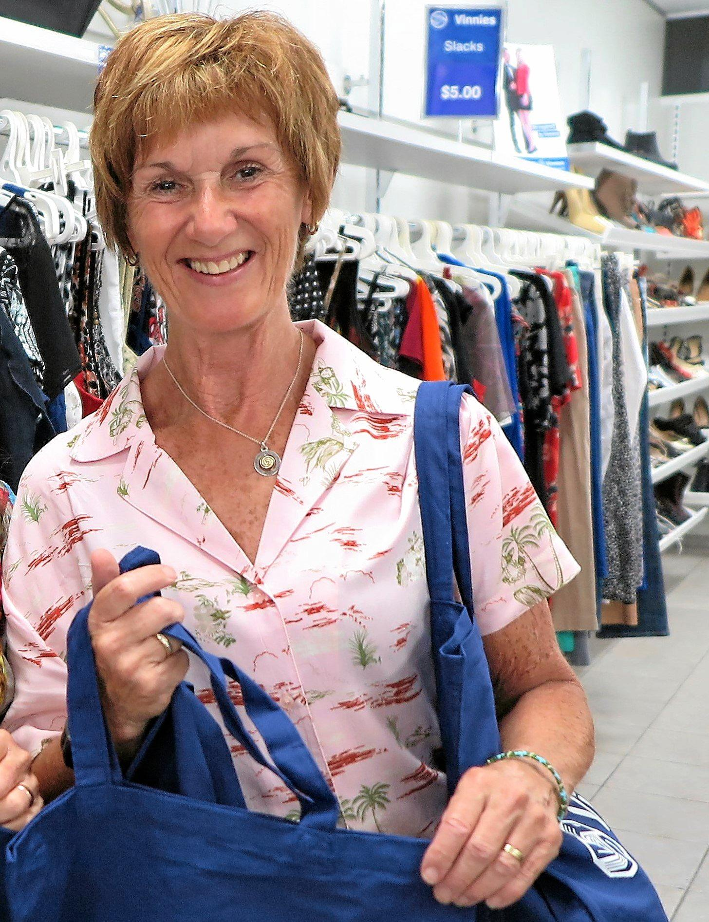 BAG A BARGAIN: Yvonne Wynen from Vinnies is encouraging shoppers to bring their own bags or purchase a Vinnie's cloth bag.