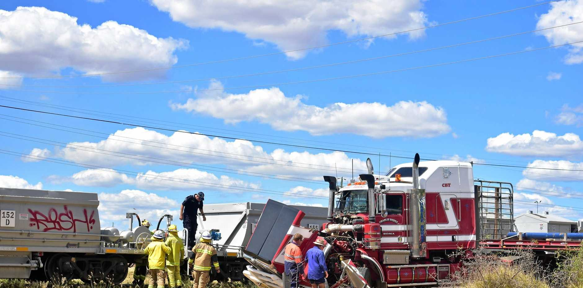 Emergency services were called to a crash between a prime mover and a train on Roma Downs Rd this afternoon.