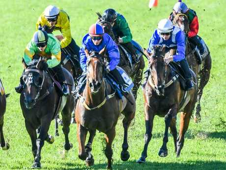 Jockey Hugh Bowman and Winx (right) work home nicely for fifth at Rosehill.