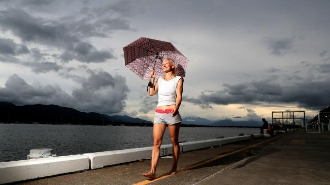 Rossi Postler covers herself from the threat of heavy rain which is forecast for the Far North starting tonight and through to Tuesday PICTURE: JUSTIN BRIERTY