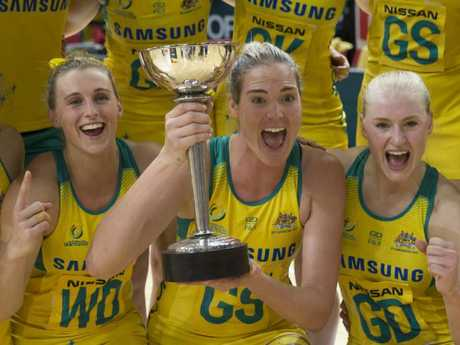 Caitlin Bassett of the Diamonds holds the Constellation Cup last year after Australia's win over New Zealand.