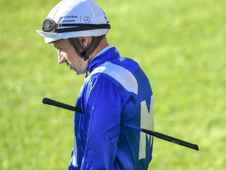Plenty on his mind: Hugh Bowman before riding Winx in Monday morning's barrier trial. Picture: AAP