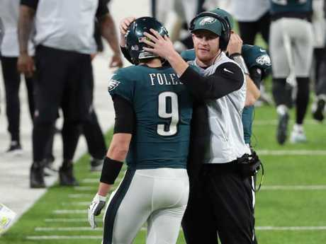 Nick Foles congratulated by Carson Wentz.