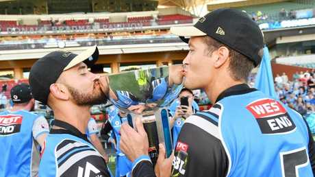 Strikers stars Jake Weatherald and Alex Carey celebrate with the trophy after defeating the Hobart Hurricanes in the Big Bash League final on Sunday. Picture: AAP Image/David Mariuz