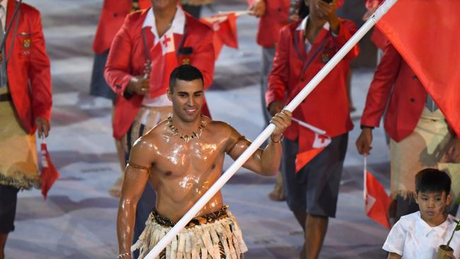 Tonga's flag-bearer Pita Nikolas Taufatofua leads his delegation during the opening ceremony of the Rio 2016 Olympic Games.