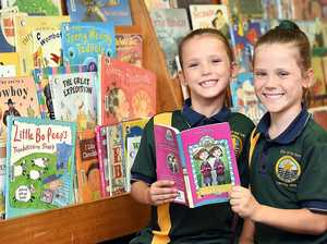 Twins share love of books, even mum's 70s edition