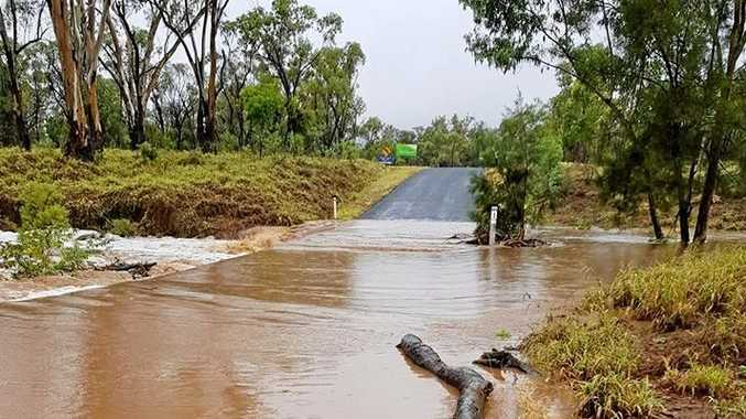 The rain caused Douglas Creek to flood the Rubyvale Rd crossing, creating a dangerous situation for motorists.