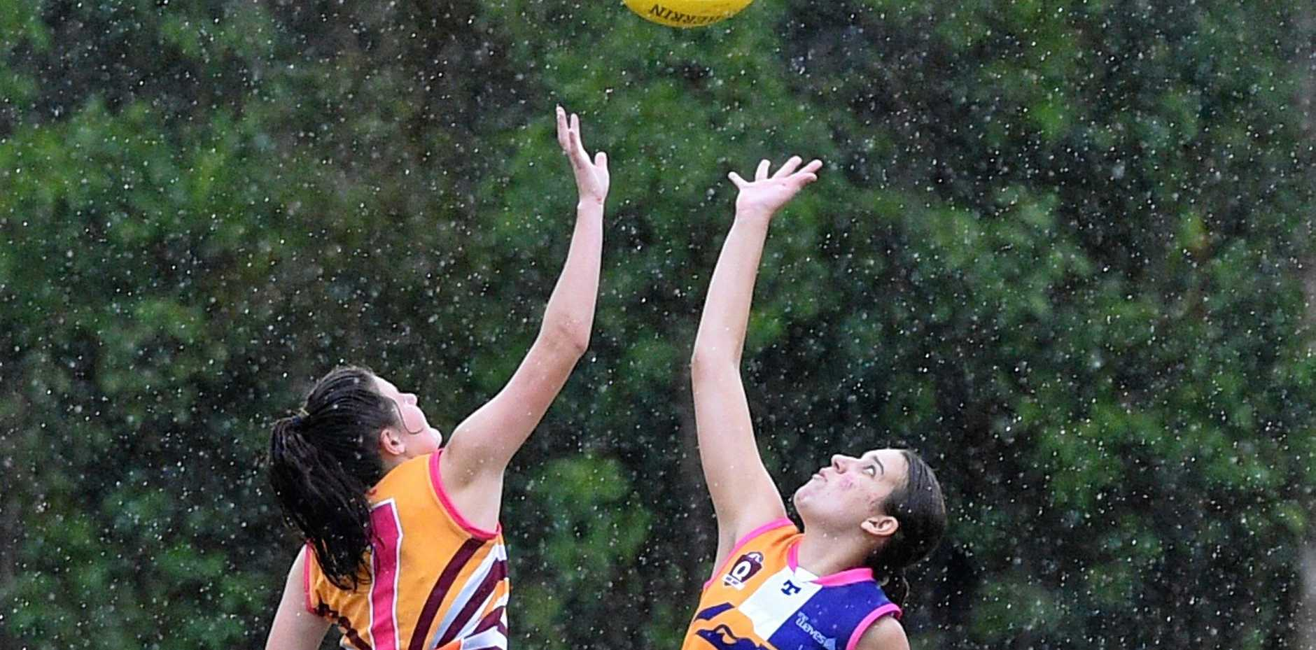 CONTEST: The Waves' Ashleigh Allen tries to win the ruck battle against Maryborough Bears player Sinead Sheehan.