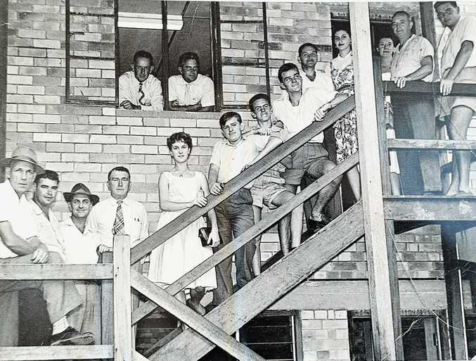 CELEBRATING OUR HISTORY: Gympie Times Staff at the opening of the new building between Mary St and Nash St in 1952. (At the window) Terry Ramsey and Ron Ronald, with (from left) Jack Bennett, Ray Clark, Norm Phillips, Ira Pilkington, June Dodt (now Reilly), Stan McBride, Sam Steele, Wes Fleming, Barry Cornwell, Heather Saxelby (Macdonnell), Nancy McGregor, Kep Jeynes and Jim Saunders.