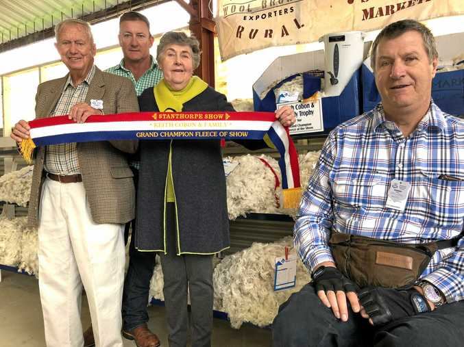 CHAMPION SPONSORS: Keith (left), John (far right) and Helen Cobon with chief steward for the wool competition Peter Reimers (back).