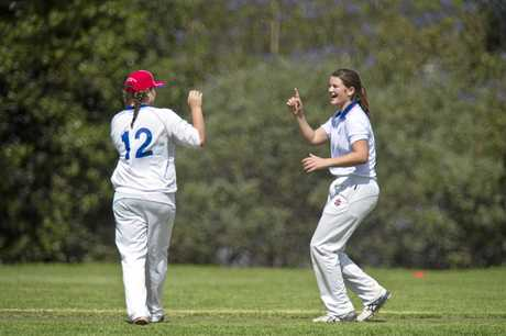 Ruth Johnston celebrates a wicket during the Queensland School Sport 13-15 years girls Cricket Championships.