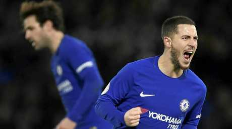 Eden Hazard celebrates after scoring against Watford.