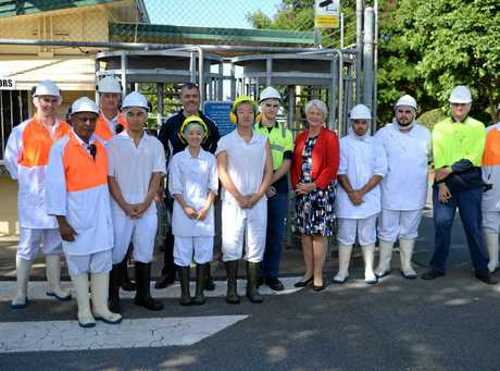 Teys General Manager of Operations Wasantha Mudannayake, General Manager of Corporate Services Tom Maguire and Rockhampton Region Mayor Margaret Strelow with some of the new Teys employees.