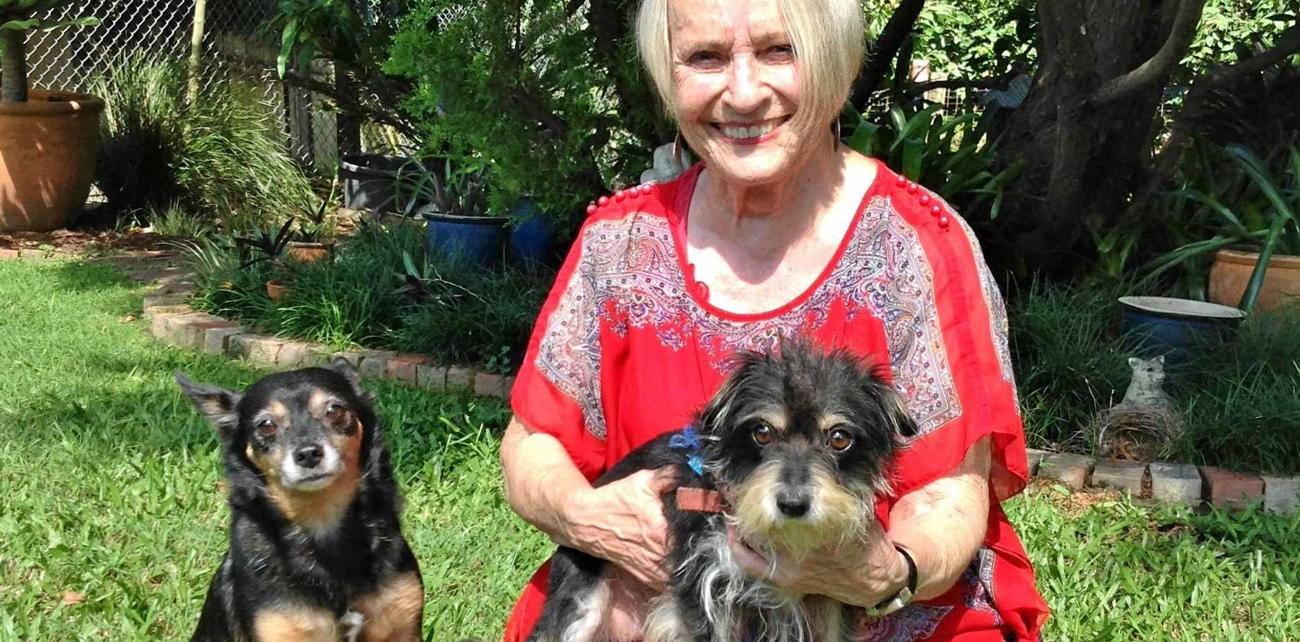 FOSTER MOTHER: Dawn McInnes with her rescue dogs and now family members, Louie and Sadie.