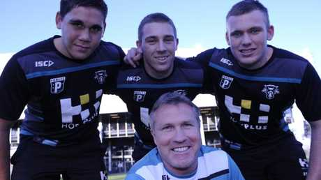 Garth Brennan with Chris Smith (left), Bryce Cartwright and Matt Lodge during his days as Panthers under-18s coach in 2012.
