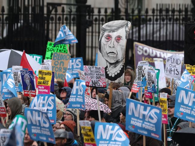 Protesters demand more money for the state-funded NHS in the UK at a protest on Saturday. Picture: Daniel LEAL-OLIVAS