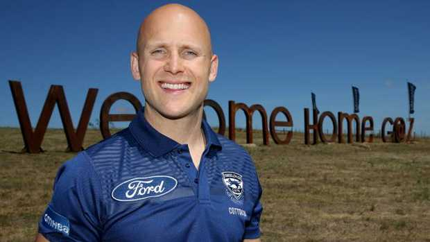 Geelong Cats star Gary Ablett with his 'Welcome home Gaz' sign. Picture: Mike Dugdale