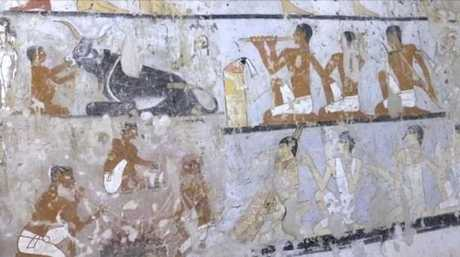 Inside the tomb of an Old Kingdom priestess adorned with well-preserved and rare wall paintings on the Giza plateau in Cairo