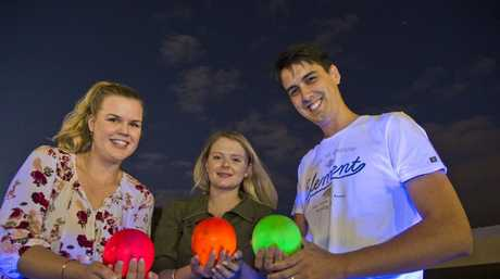 Enjoying the new concept of glow bowls are (from left) Emma Tedford with Nikita and Nathaniel Kok at City Bowls Club, Tuesday, February 6, 2018.
