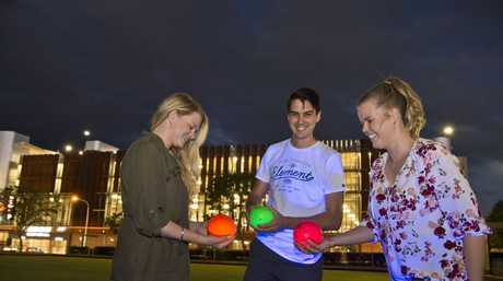 Enjoying the new concept of glow bowls are (from left) Nikita and Nathaniel Kok with Emma Tedford at City Bowls Club, Tuesday, February 6, 2018.