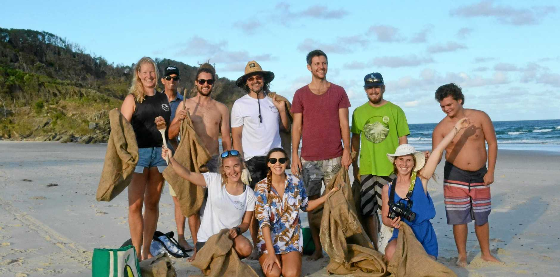 POSITIVITY: The crew from Positive Change for the Marine Environment at a recent Beach Clean Up.