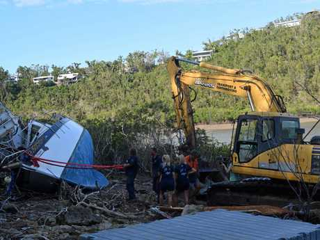 Luke and his team salvaging The Pacific Dragon and the North Star, stranded on the shores at Shute Harbour.