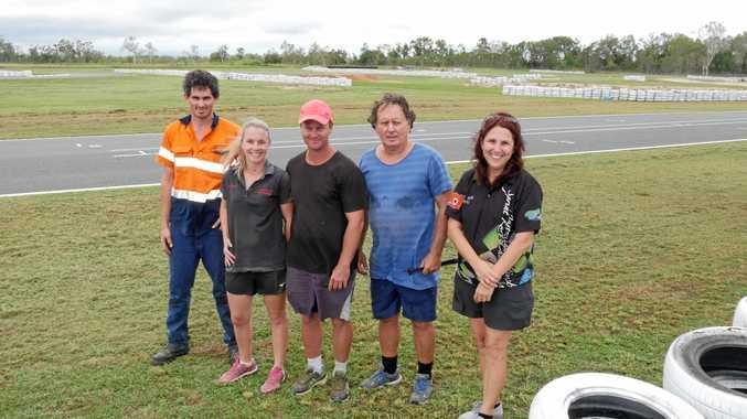 ALL SMILES: Whitsunday Motorsport Club members Andy Mcliesh, Madeline Thornburn, Bob Thornburn, David Carriline and Tracey Stroud.