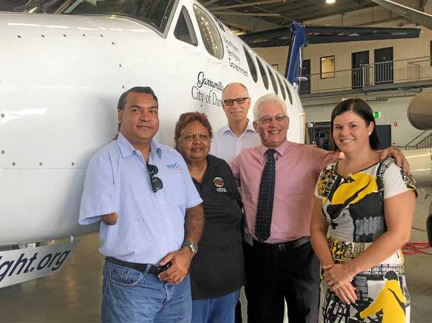 PRAISING THE NEW AIRCRAFT: Richard Fejo who performed the Welcome to Country, Pauline Babar, Larrakia Elders Committee Member, Chairman of the CareFlight Board of Directors, Andrew Refshauge, Darwin Lord Mayor Kon Vatskalis and NT Minister for Health Natasha Fyles.