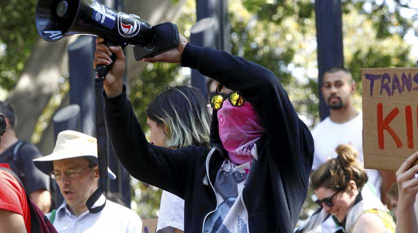 A protester is seen during a