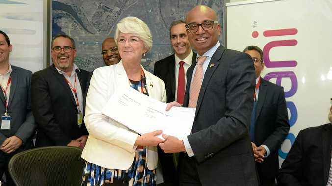 L-R Rockhampton Mayor Margaret Stelow with Adani Australia CEO Jeyakumar Janakaraj sign the MOU regarding the Charmichael Mine FIFO hub.