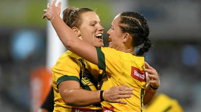SHARING THE CUP: Mackay duo Renae Kunst and Brittany Breayley were part of the Jillaroos' 2017 World Cup winning team. Kunst will display the trophy at this Sunday's Sports Expo and Sign On Day.