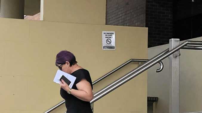 Brenda Leanne Macklin leave court after an appearance on fraud charges