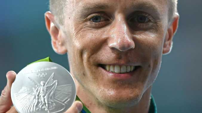 Australia's Jared Tallent displays his silver medal following a presentation for the Men's 50k walk at the Olympic Stadium at the Rio 2016 Olympic Games.