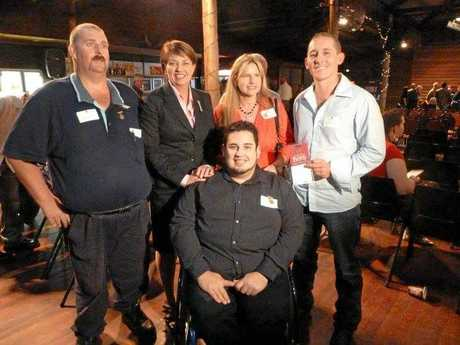 Andrew (far left) received a Queensland Disaster Hero's medal for services to his community after he helped with the Cyclone Yasi Update page and.
